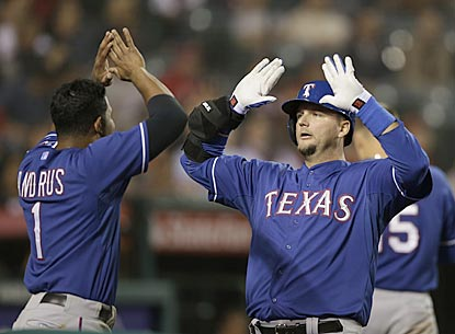 Elvis Andrus greets A.J. Pierzynski after the Rangers catcher puts Texas ahead to stay with a home run in the ninth inning.  (AP)