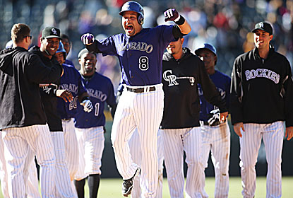 Yorvit Torrealba (center) is the hero as the Rockies halt a three-game losing streak. (USATSI)