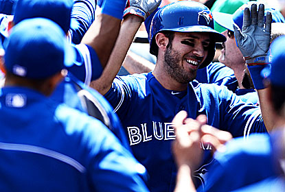 J.P. Arencibia gets kudos after his two-run homer to help snap the O's extra-inning win streak at 17. (Getty Images)