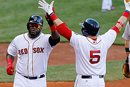 David Ortiz (left) -- celebrating with Jonny Gomes -- has two hits and drives in a run for the Red Sox, coming off a 13-0 loss. (Getty Images)