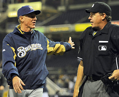 Brewers skipper Ron Roenicke argues a batter's interference call that ends the game and snaps their nine-game win streak. (USATSI)