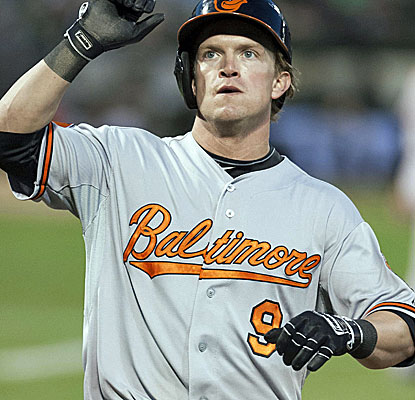 Nate McLouth reaches base four times and scores twice in the Orioles' easy win over of the A's. (USATSI)