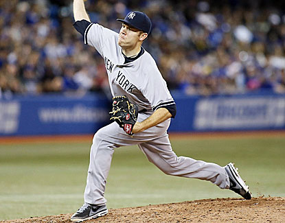 David Phelps strikes out a career-high nine in four innings after relieving injured Yankees starter Ivan Nova. (USATSI)