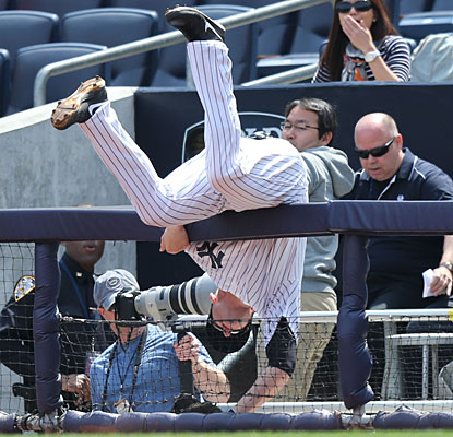 Lyle Overbay doesn't limit his contributions to offense, going all out in pursuit of a foul ball.  (USATSI)