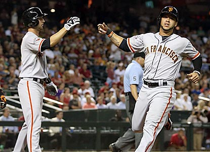 Nick Noonan (left) greets Gregor Blanco after both Giants score on Brandon Belt's game-deciding hit in the eighth inning.  (Getty Images)