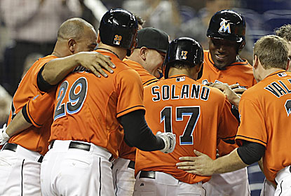 The Marlins, last in the majors in runs, get a little help with a wild pitch to win their season-high third in a row. (AP)