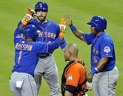 Jordany Valdespin celebrates with Lucas Duda (left) and Marlon Byrd after hitting a three-run homer in the sixth inning. (USATSI)