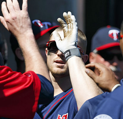 The Twins congratulate Chris Parmelee, who provides an insurance run with a HR in the eighth inning. (USATSI)