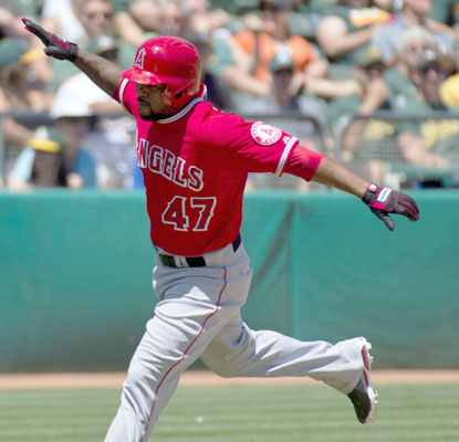 The Angels' Howie Kendrick rounds the bases in the first inning after hitting a home run off Tommy Milone.  (USATSI)