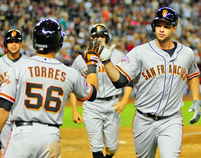 Brandon Belt (right) celebrates with Andres Torres after hitting a three-run home run in the eighth inning. (USATSI)
