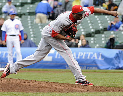 Reds star reliever Aroldis Chapman gets the hook after giving up three earned runs to the Cubs in the 9th inning. (Getty Images)