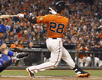 Buster Posey hits a game-ending home run into the left-field seats leading off the bottom of the ninth. (Getty Images)