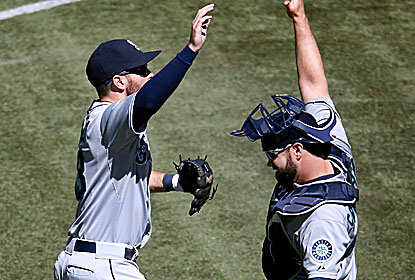 Dustin Ackley -- who hits his first grand slam -- celebrates the win with teammate Kelly Shoppach. (Getty Images)