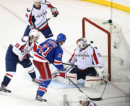New York's Derek Stepan scores the winning goal against Washington's Braden Holtby in the third period.  (USATSI)