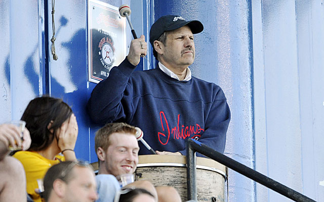 Indians fan John Adams beats a drum in center field, but only a few fans were on hand to hear it. (USATSI)