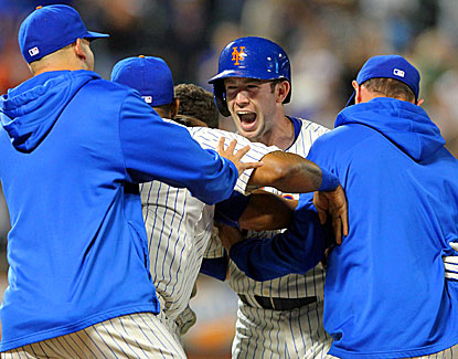Mike Baxter (center) celebrates with his Met teammates after his game-winning RBI against the White Sox in the 10th inning. (USATSI)