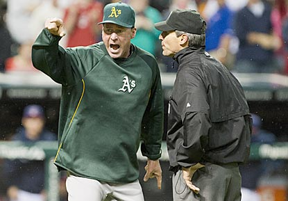 Umpire Angel Hernandez is unmoved by Bob Melvin's passionate argument following the video review, and ejects him.  (Getty Images)