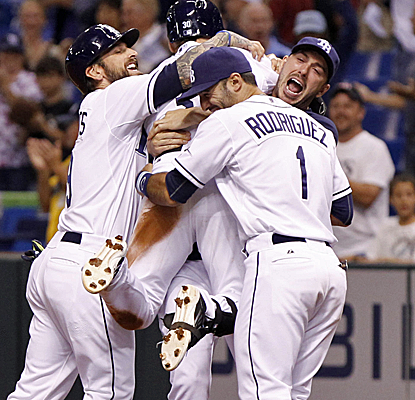 Tampa players celebrate Luke Scott's game-winning walk as the Rays knock off the Blue Jays.  (USATSI)