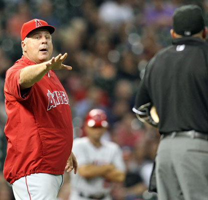 Mike Scioscia argues with the umpires, disputing an Astros pitching change in the seventh inning.  (USATSI)