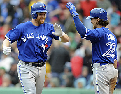 Toronto's Adam Lind, left, celebrates his go-ahead homer in the ninth with Colby Rasmus in the Jays' 3-2 win over Boston. (USATSI)