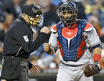 Cleveland catcher Carlos Santana is pumped after Ubaldo Jimenez fans Andy Dirks to end the fourth. (USATSI)