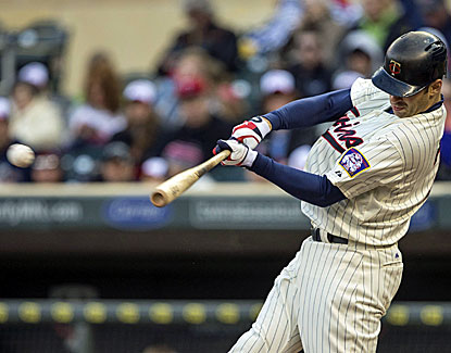 Joe Mauer has three hits and collects his 600th career RBI in the Twins' win over Baltimore. (USATSI)