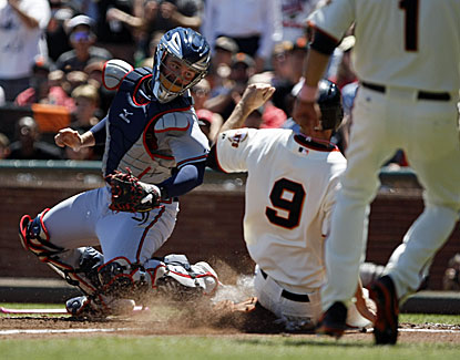 Brandon Belt slides past Brian McCann on Brandon Crawford's RBI single in the fourth. (USATSI)