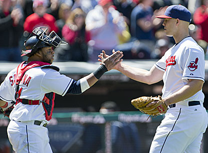 Indians pitcher Justin Masterson (right) celebrates with Carlos Santana after tossing a four-hit shutout against the Yankees. (Getty Images)