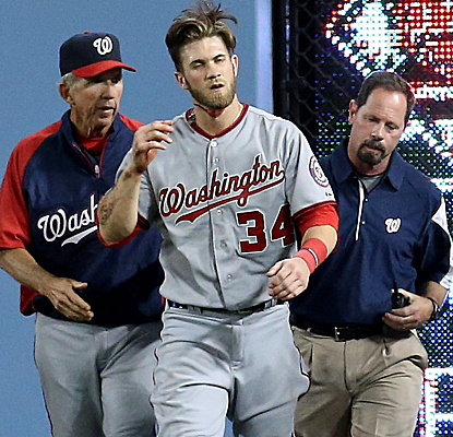 Bryce Harper is looking a little dazed after running head first into the wall chasing a fly ball.  (Getty Images)