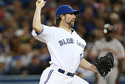 R.A. Dickey -- a winner for the first time since April 18 -- strikes out 10 for the Jays, who bang out a season-high 18 hits. (Getty Images)