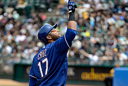 Nelson Cruz hits a three-run homer and also makes a run-saving, diving catch to end the sixth inning. (Getty Images)