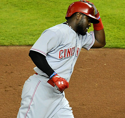 Brandon Phillips homers in the sixth inning and drives in the go-ahead run with a sacrifice fly in the 10th. (USATSI)