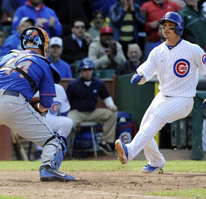The Cubs' Darwin Barney is thrown out at home attempting to score the tying run in the bottom of the eighth inning.  (USATSI)