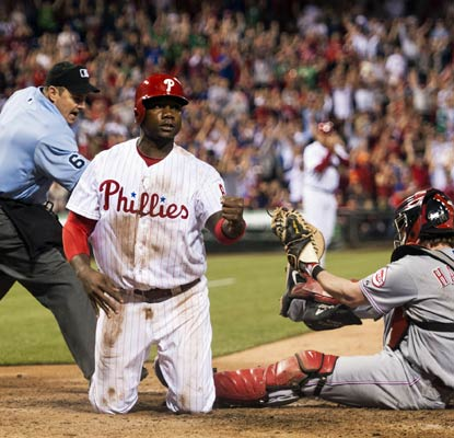Ryan Howard beats the tag at home plate to score an insurance run for the Phillies in the eighth inning.  (USATSI)