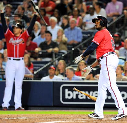 Justin Upton watches his grand slam in the sixth inning and ends the night with five RBI.  (USATSI)