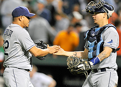 Joel Peralta steps out of his normal setup role to earn the save for the Rays in a wild game.  (Getty Images)