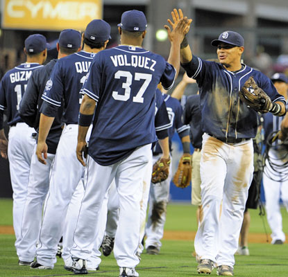 Everth Cabrera (right), who knocked in the go-ahead run in the eighth, high-fives Edinson Volquez after the win. (Getty Images)