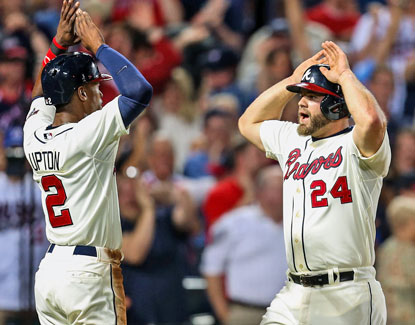 Evan Gattis (right) celebrates with B.J. Upton after hitting a two-run home run in the eighth inning. (USATSI)