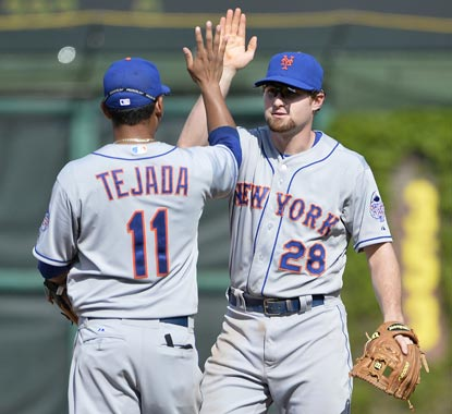 Ruben Tejada and Daniel Murphy have reason to celebrate after the Mets win their first series in Wrigley since 2007.  (Getty Images)