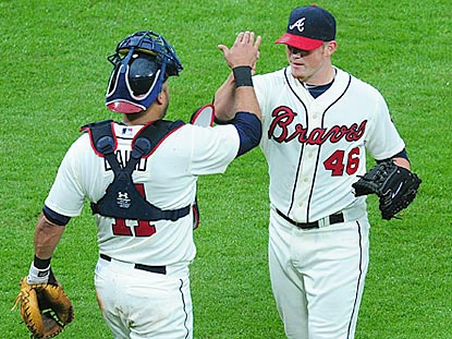 After Gerald Laird (left) helps Atlanta take the lead in the eighth inning, Craig Kimbrel strikes out the side in the ninth. (Getty Images)