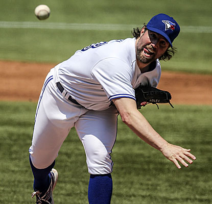 R.A. Dickey goes a season-high eight innings for Toronto, allowing three runs and four hits but getting a second straight win. (Getty Images)