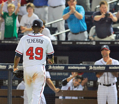 Braves fans applaud Julio Teheran, who pitches 8 1/3 dominant innings for his third win of the season. (USATSI)