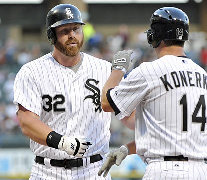Paul Konerko (right) congratulates fellow veteran Adam Dunn after Dunn blasts a three-run HR in the first inning. (USATSI)