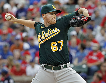 Rookie Dan Straily strikes out five and allows just two hits in seven innings of work during the A's win, their fifth straight. (Getty Images)
