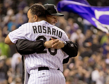 Manager Walt Weiss embraces Wilin Rosario, who delivers the game-winning single in the 10th. (Getty Images)