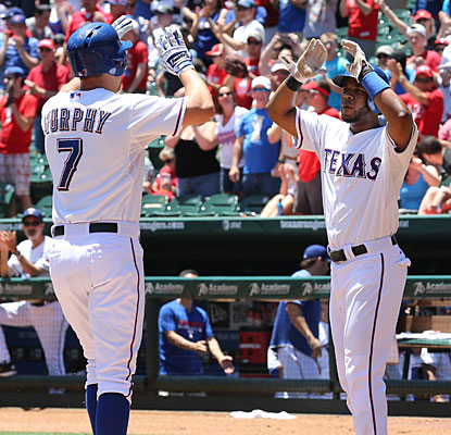 David Murphy's first-inning home run, driving in Elvis Andrus, is all the Rangers need to beat the A's.  (USATSI)