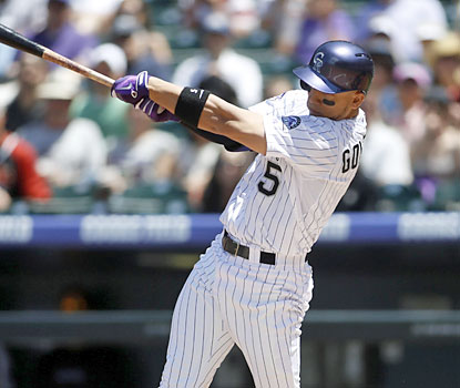 Carlos Gonzalez finishes 2 for 4 at the plate with a triple and a home run -- his 11th on the season. (USATSI)