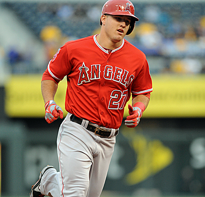 Mike Trout rounds third base after delivering a monster home run well over the 410-foot center-field fence.  (USATSI)