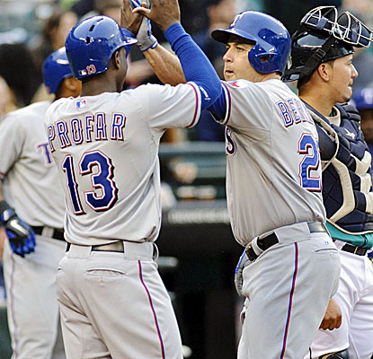 Veteran Lance Berkman celebrates his three-run homer with Rangers rookie Jurickson Profar. (Getty Images)