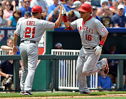 Hank Conger (right) rounds the bases after hitting a solo homer against the Royals in the sixth inning. (USATSI)